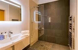 Each bedroom has an en suite shower