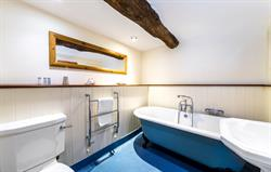 Thatched ensuite bathroom