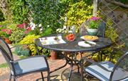 Relax or dine in the pretty garden